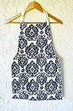 Girls apron in beautiful prints fits tweens age 8-11 reversible.