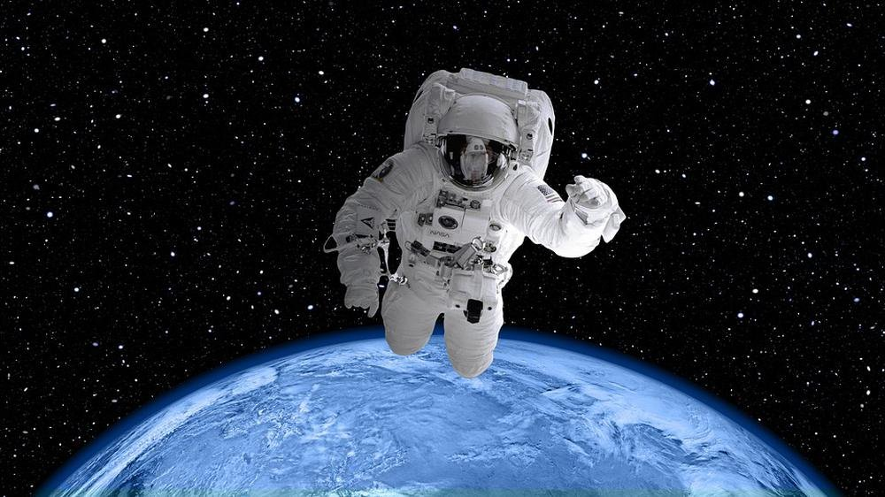 Gifts Delight Laminated 42x24 inches Poster: Space Suit Astronaut World Earth Planet Globe Space View Blue Space Cosmos Universe NASA Space Travel Shuttle Star Science Astronomy