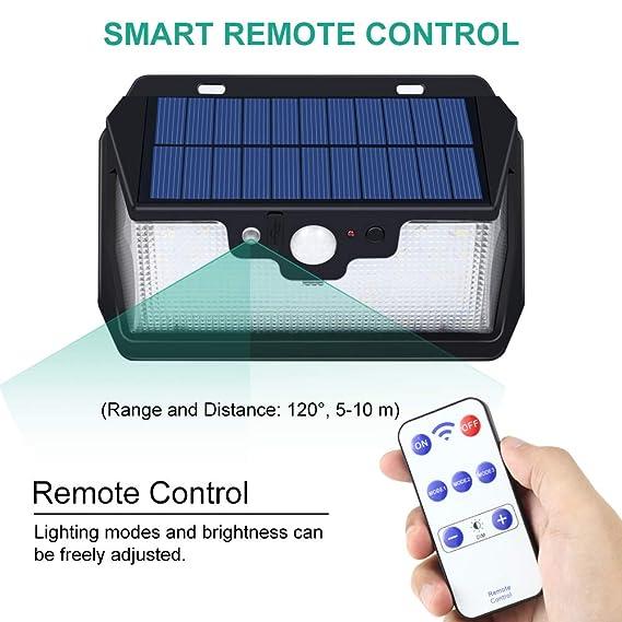 Bovon Luz Solar, 55 LED Foco Solar con Sensor de Movimiento, Luces Solares Exterior con Control Remoto y Carga USB, Lámparas Solares Impermeable para Jardín ...