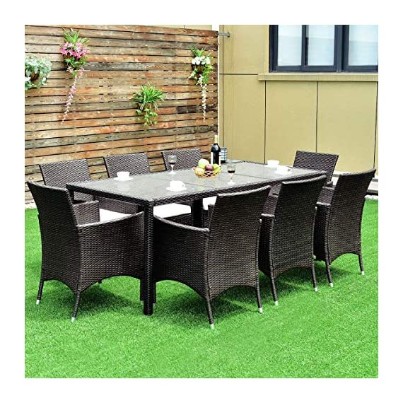 Tangkula 9PCS Patio Wicker Furniture Set Outdoor Garden Modern Wicker Rattan Dining Table Chairs Conversation Set with Cushions, Brown (9 PCS) - ❀Catch Your Eyeballs: Equipped with 8 single cushioned chairs and 1 glass dining table, it adopts solid steel frame and PE wicker with sponge cushions catching your eyeballs and guaranteeing you a durable using experience. The stylish dining set design doubles the comfort for you chatting and eating with your families and friends. ❀Moment to Carry: Made of lightweight rattan material, it can be carried easily and labor-efficiently to the desired place. Its compact structure and beautiful texture can surprisingly highlight your patio or poolside deco. Its compact design is perfect for a small deck, patio, balconies, apartment or terrace. ❀Effortlessly Clean Up: Table with removable tempered glass adds a sophisticated touch and allows you to places drinks, meals and other accessories on top. And you can clean it easily with just a wipe when there is water strain on it. The separable seat cushion also enables you a quick wash. - patio-furniture, dining-sets-patio-funiture, patio - 61glXFIn9lL. SS570  -