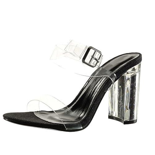 Bonitas sandalias con suela negra y con tacon y sujecciones transparentes.