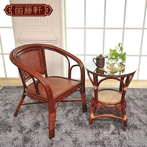 HOOM-Una silla de mimbre sofá y mesa sillas salón habitación con ...