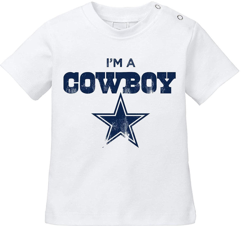 American Football Baby T-Shirt Bio Baumwolle EZYshirt/® I`m a Cowboy