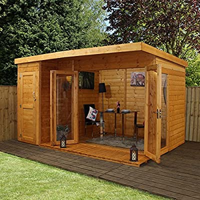 12 x 8 summerhouse with a storage shed is a real looker in this garden sitting on the lawn