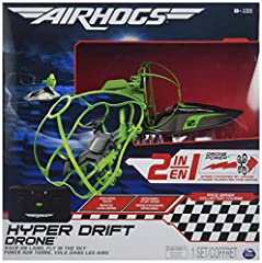 "Race on land and blaze across the sky with 2-in-1 Air Hogs Hyper Drift Drone! This RC speeder, measuring 8"" x 3"" x 2.5"", is both a land vehicle and flying drone! Powered by a turbo drone engine, it can achieve breakneck speed on the ground. W..."