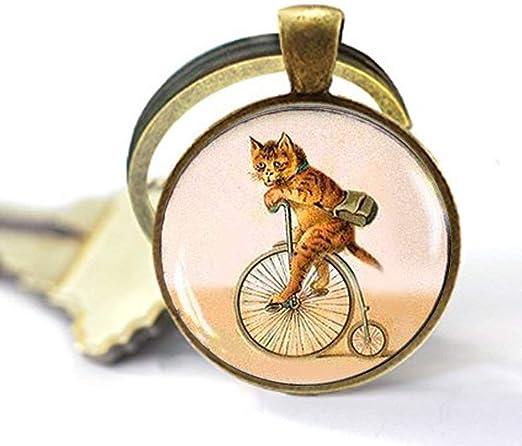 Collar o llavero para bicicleta con diseño de gato sobre gato, estilo vintage, ideal como regalo para los amantes de las bicicletas: Amazon.es: Hogar