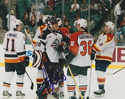 Autographed Ryan Miller Photograph - with