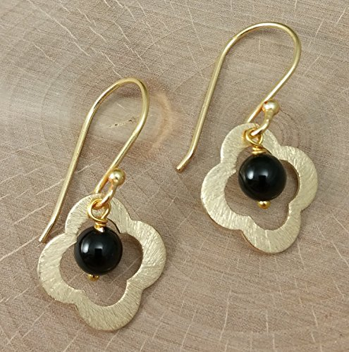 a-pair-of-modern-gold-flower-with-black-onyx-gemstone-dangle-earrings-in-a-brushed-finish