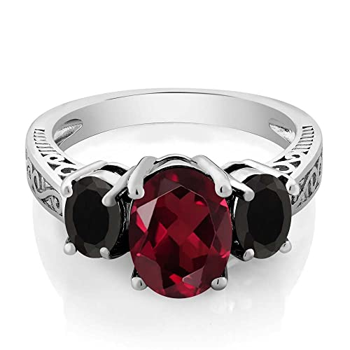Gem Stone King Sterling Silver Red Rhodolite Garnet Black Onyx 3-Stone Women s Ring 2.98 cttw, Center Stone 9x7mm Available 5,6,7,8,9