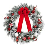 Create a vibrant splash in your home with this beautiful 30 in. Flocked Pine Wreath. Perfect for the holiday season, this colorful wreath is artfully decorated with red, white and silver balls of different shapes and textures accented with re...