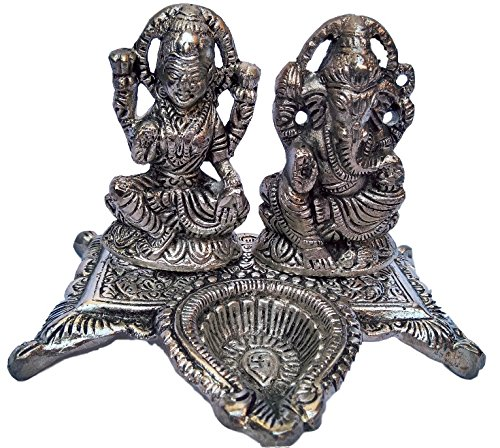 Buy White Metal Laxmi And Ganesh Idols With Chowki And Diya Online