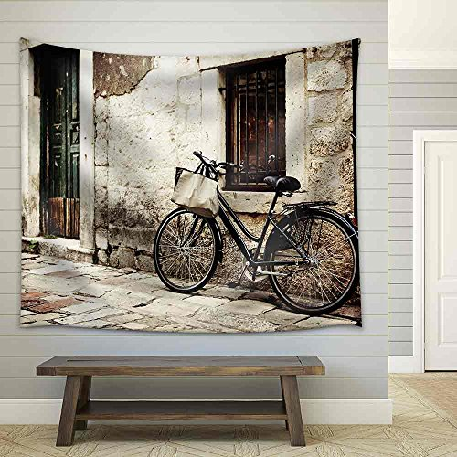 Bicycle with a Shopping Bag on Handle Bar Left Beside Old Stone Wall Fabric Wall
