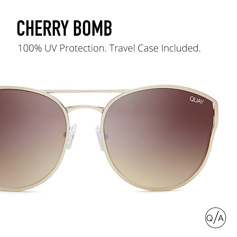 b5607cdd15 Amazon.com  Quay Australia CHERRY BOMB Women s Sunglasses Large Round Cat  Eye - Gold Brown  Quay  Clothing