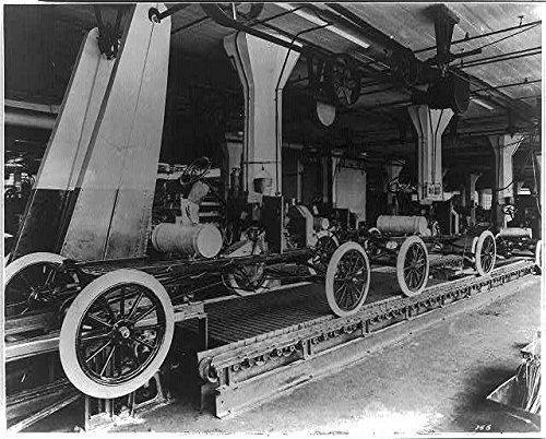 Historic Photos 1913 Photo Assembly line at The Ford Motor Company's Highland Park Plant Unfinished Model T's Rolling on The Assembly line. Location: Highland Park, Michigan