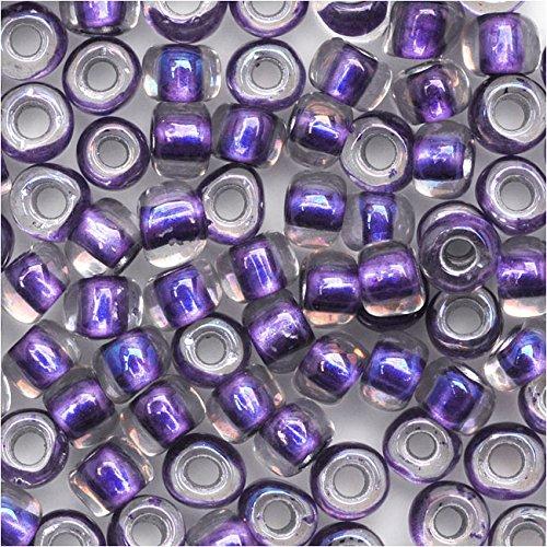 Toho Round Seed Beads 6/0#265 'Rainbow Crystal/Metallic Purple Lined' 8 Gram ()