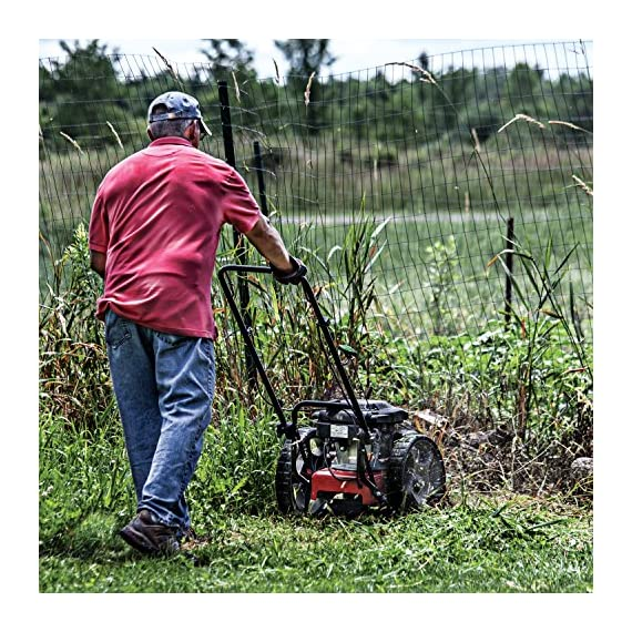 "Earthquake 28463 m205 trimmer with 150cc 4-cycle viper engine walk behind string mower, red/black 2 powerful - powered by a strong, yet quiet, 150cc 4-cycle viper engine. The earthquake m205 walk behind string mower chops down your unsightly weeds and stubborn brush with ease. The large 14-inch wheels allow you to float through thick grass, weeds, brush, nettles, and other foliage too difficult for push mowers to overcome. Durable - our one-piece steel deck provides strength and stability while reducing vibration. Super tough nylon line has a cutting swath of 22"" to get the job done quickly. Never kill engine: unlike many competitive units, our engine will continue to run when the cutting head is disengaged so you can safely and easily remove sticks, branches or other obstacles without having to re-start the engine, saving time and frustration."