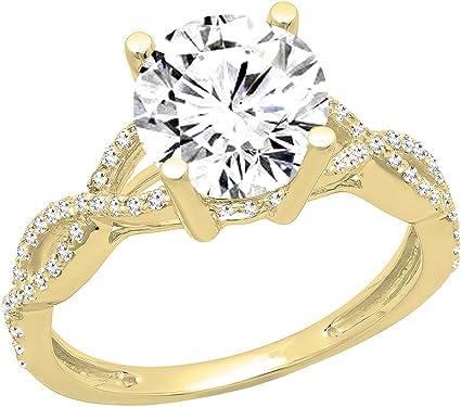 anillo de oro amarillo con diamante grande central de 1.75 quilates caro