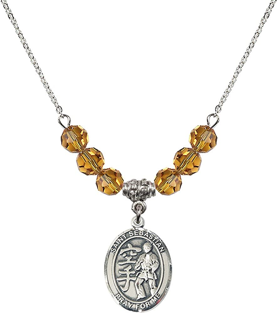 18-Inch Rhodium Plated Necklace with 6mm Topaz Birthstone Beads and Sterling Silver Saint Sebastian//Karate Charm.