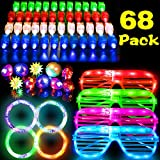 SIXONE 68 Pack LED Light Up Toys Party Favors Glow in the Dark Party Supplies with 50 Finger Light Up Toys 10 Flashing Bumpy Rings 4 Bracelets 4 Flashing Slotted Shades Glasses for Adults and Kids Halloween Christmas