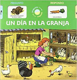 Un día en la granja (Spanish) Hardcover – April 1, 2009