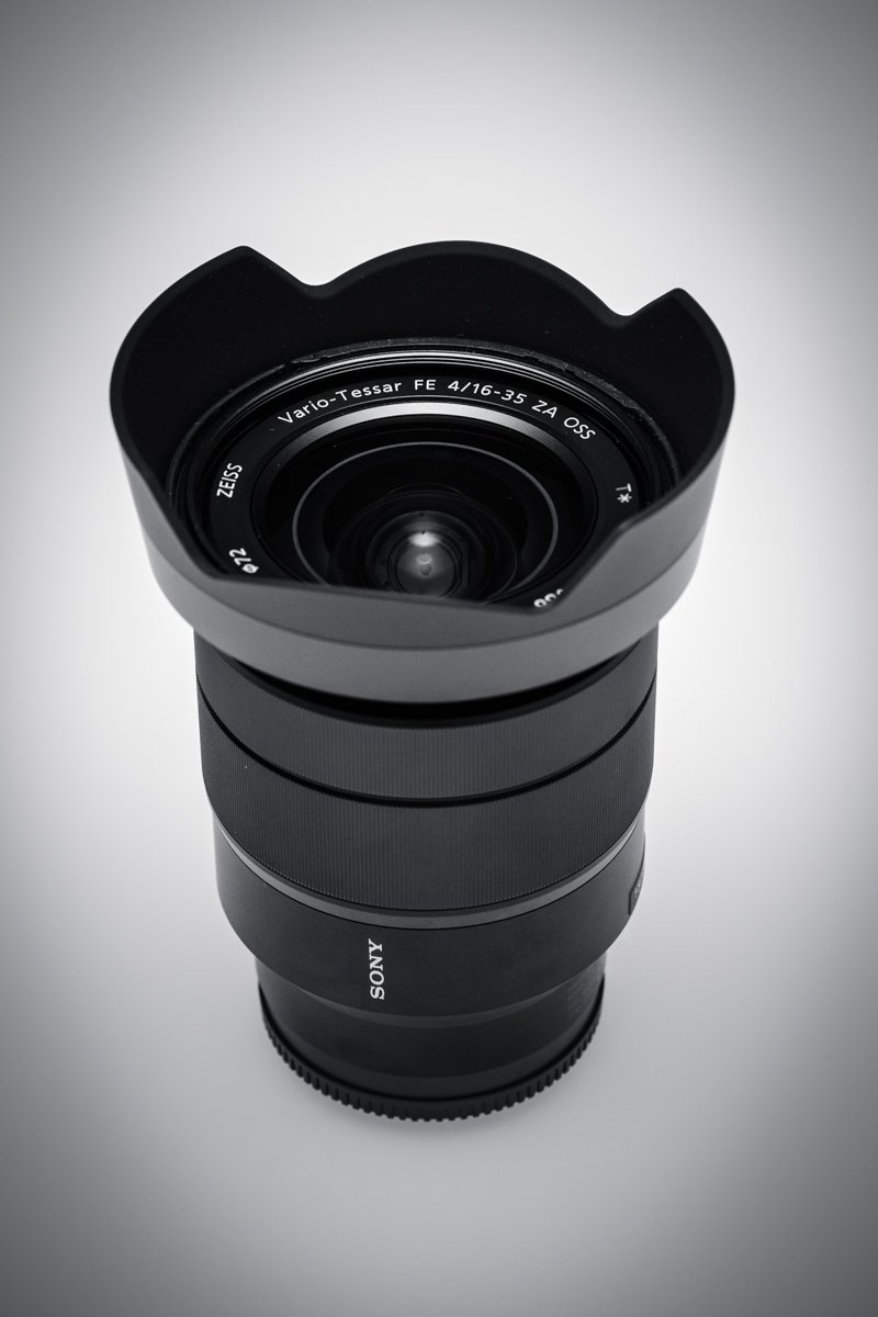 Sony 16-35mm Vario-Tessar T FE F4 ZA OSS E-Mount Lens + 3PC Multi-Coated Filter Kit (UV+CPL+FLD) + Microfiber Cleaning Cloth