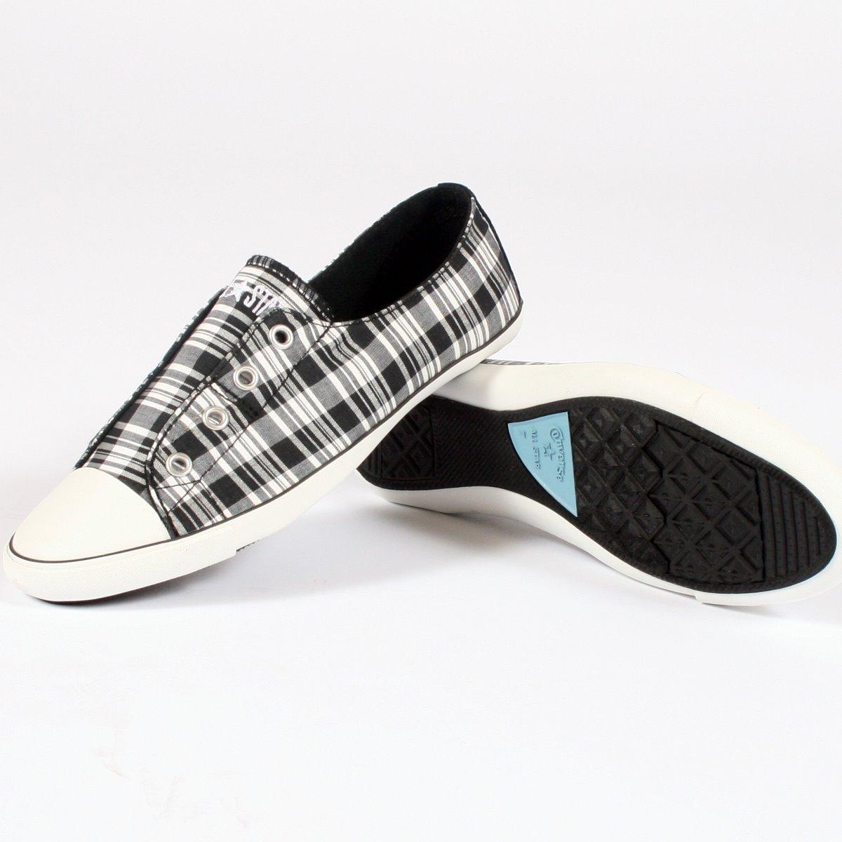 Converse All Star Slip On Low Top Schuhe in schwarz weiß