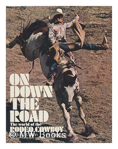 On Down the Road : the World of the Rodeo Cowboy / by Bob St. John ; Forewords by Larry Mahan and Walt Garrison ; Special Photography by Lewis Portnoy ; Designed by Allan Mogel