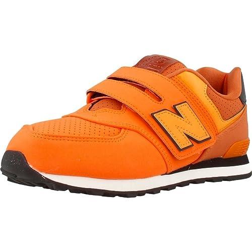 new balance niño naranja