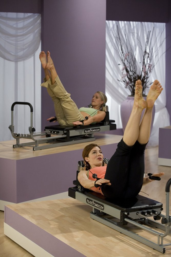 Pilates Power Gym Plus - Ultimate Pilates Power Gym mini reformer with Push Up Bar and 3 Celebrity Trainer Pilates Workout DVDs. Pilates Power Gym Push Up Bar included