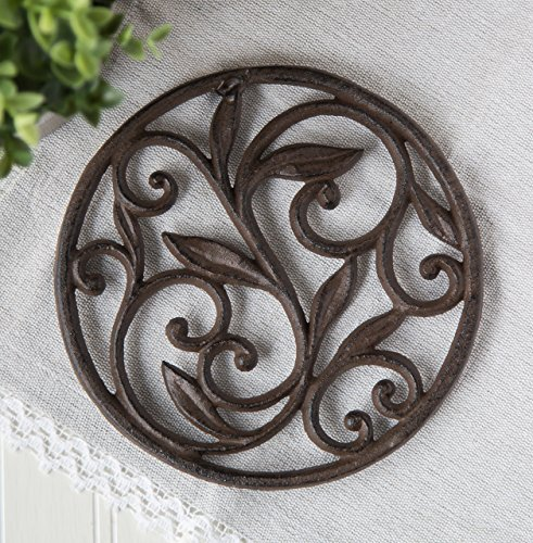 Cast Iron Trivet - Round with Vintage Pattern - Decorative Cast Iron Trivet For Kitchen Or Dining Table - 7.7 ' Diameter - Rust Brown Color - With Rubber Pegs by Comfify