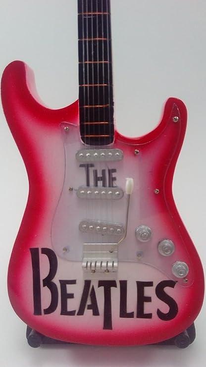 Guitarra Miniatura Colección- Mini Guitar The Beatles (Rosa Difuminado) , en color Rosa