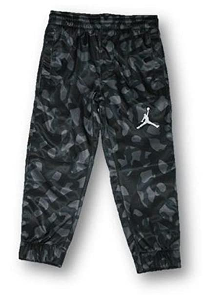 55d3aa46dbd Image Unavailable. Image not available for. Color: Nike Air Jordan Child  Boy's Camo Athletic Therma Pants ...