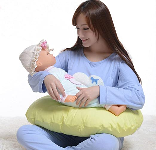 GxNI La lactancia materna del bebé bebé sentado en el T ...