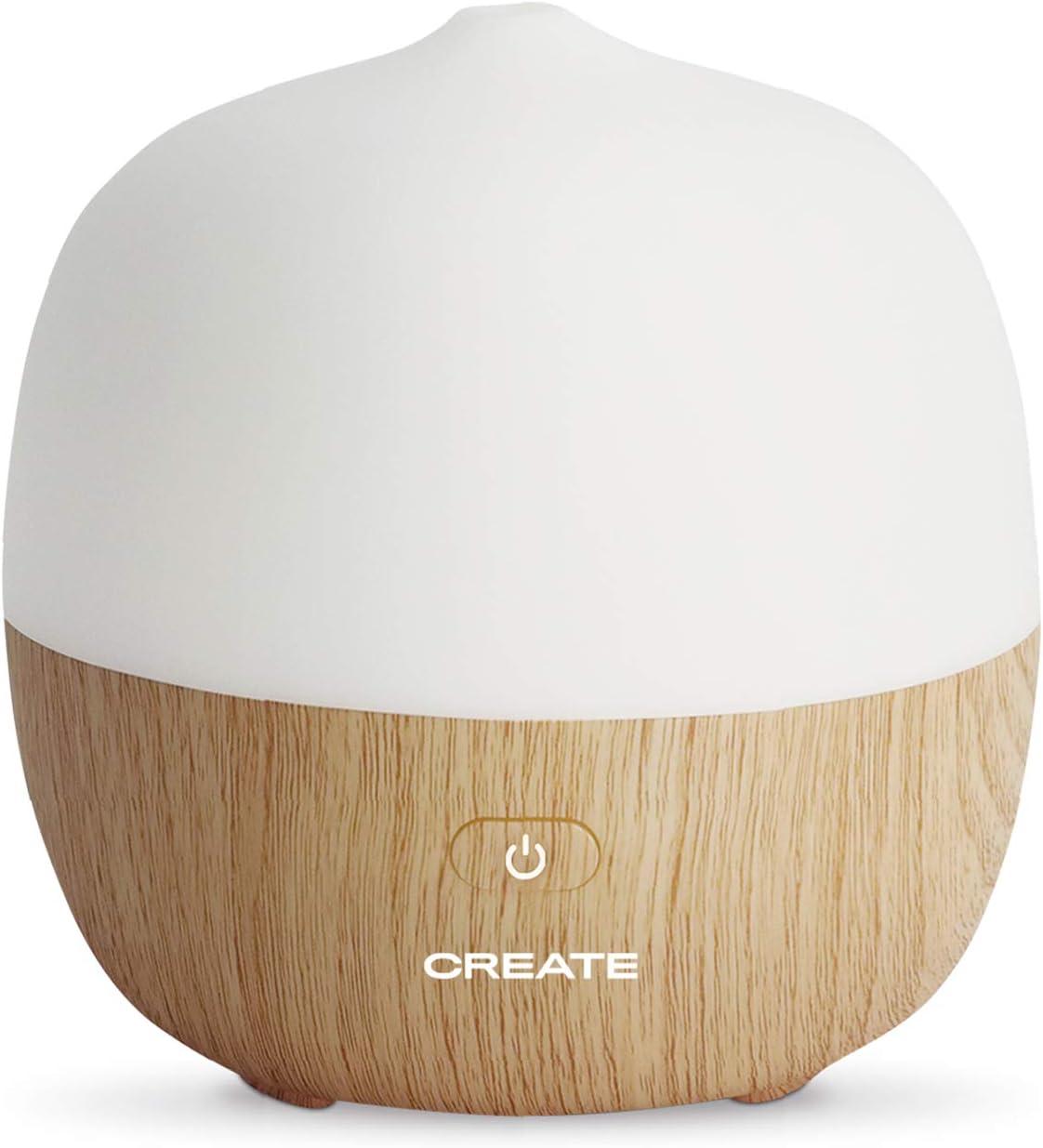 IKOHS AROMA STUDIO - Difusor de aromas y humidificador, Emite Vapor Frio con propiedades Humectantes y de Aromaterapia, 7 colores de luces LED programables, Función de Aromaterapia (Madera Natural)