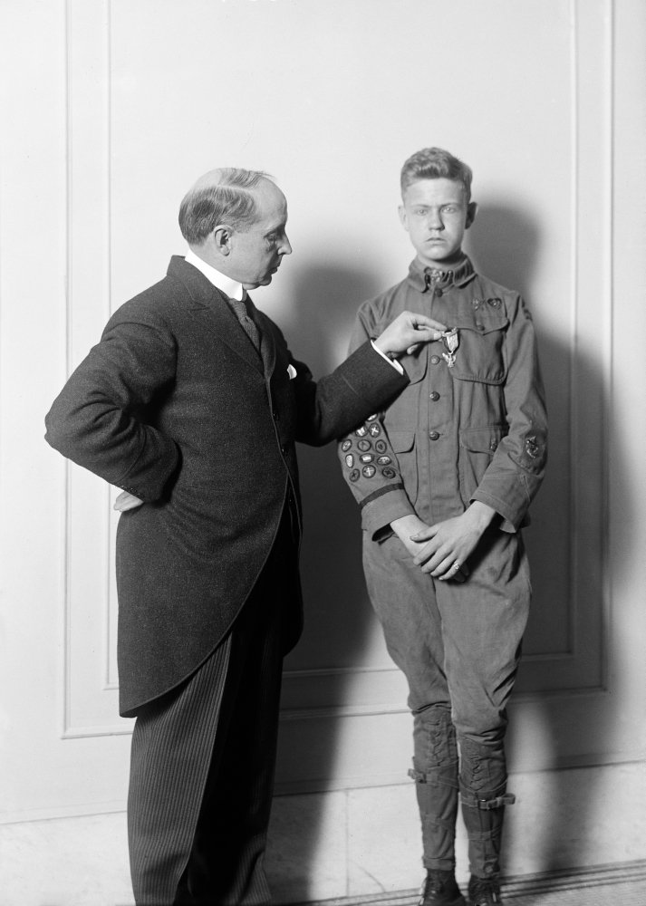 Boy Scout 1916 Nboy Scout Guard Arthur P Moses Penning A Medal To A Boy ScoutS Uniform Photograph 1916 Poster Print by (24 x 36) by Posterazzi