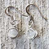 I make these small drop earrings by wire wrapping white cat's eye beads with silver plated wire. The ear wires are nickel-free hypo-allergenic surgical steel and they are safe for anyone with metal allergies. These earrings measure just over ...