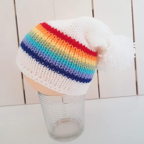 4766f9565cc Crafty Stuff Baby Knits Hand knit Rainbow Baby Slouchy Beanie hat for children  with pompom 0-3 years  Amazon.co.uk  Handmade
