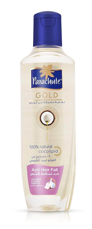 a103e141a2fe Amazon.com   Parachute Gold Hair Oil Anti Hair Fall - 6.8 fl.oz. (200ml) -  Contains Garlic And Coconut   Hair And Scalp Treatments   Beauty