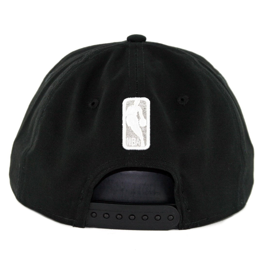 8159b0a5fe709 Amazon.com   New Era 950 San Antonio Spurs Badged Fan Retro Snapback Hat ( Black) Men s Cap   Sports   Outdoors