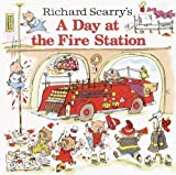 img - for Richard Scarry's A Day at the Fire Station (Pictureback(R)) by Richard Scarry (2003) Paperback book / textbook / text book