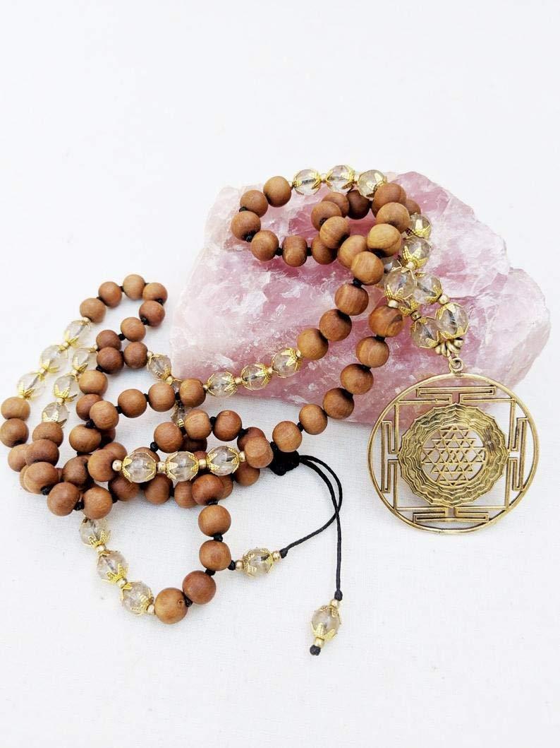 Amazon.com: Yoga Mala Rutilated Quartz Sandalwood Sri Yantra ...