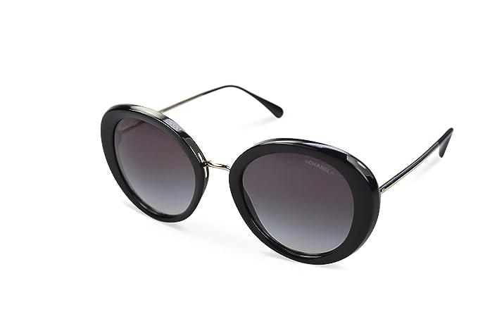 foto ufficiali 3a845 41b47 Chanel - Occhiali da sole - Donna Nero Nero, oro: Amazon.it ...