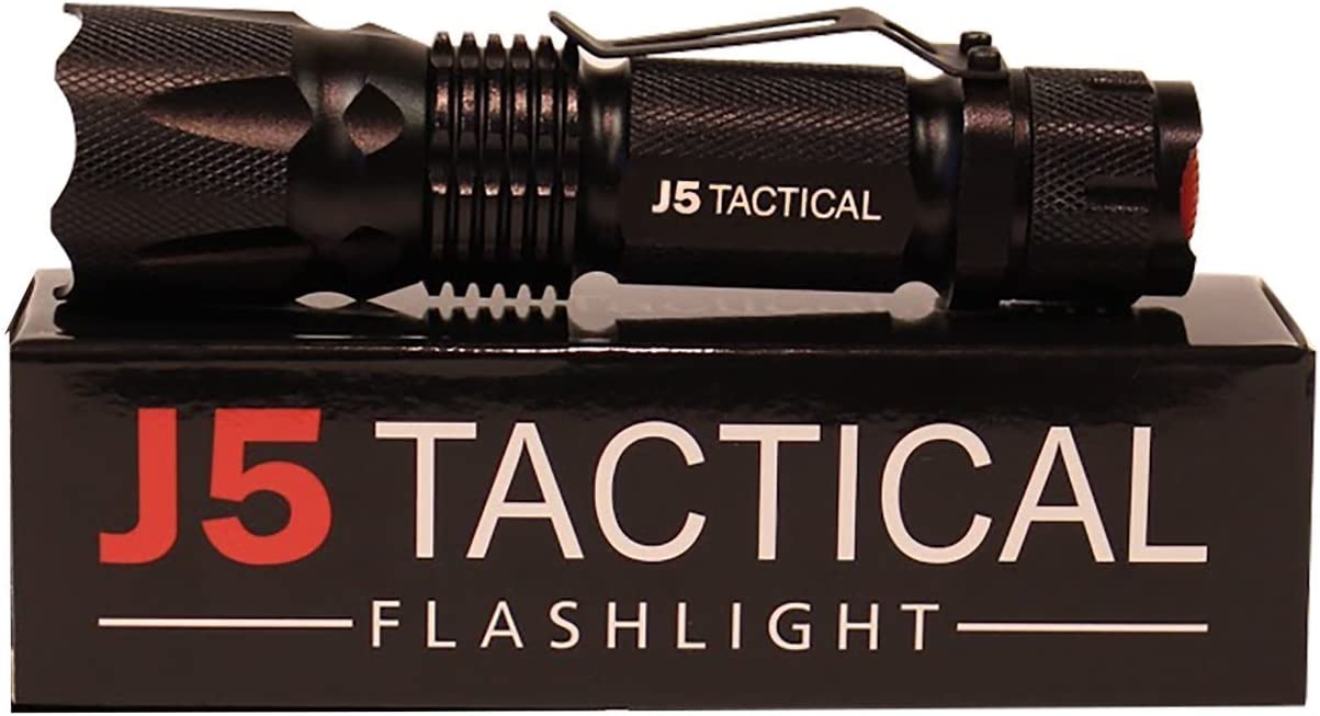 This is an image of a J5 Tactical flashlight on top of a box.