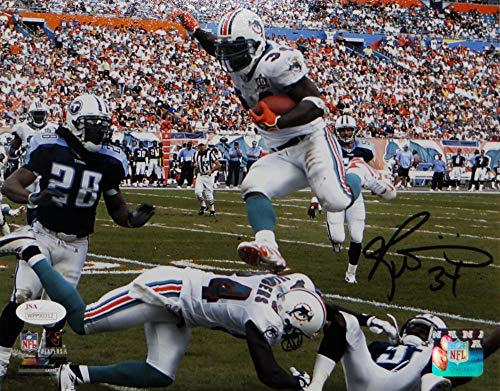 Ricky Williams Autographed Miami Dolphins 8x10 Jumping PF Photo- JSA W Auth Blk