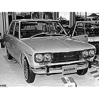 Vintage photo of A Datsun car parked.