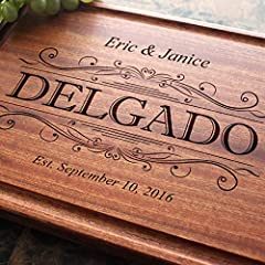 "Our personalized cutting boards and chopping blocks are engraved with a beautiful design of your choice. Our cutting boards are 0.75'' thick and made from maple, sapele or walnut wood. Chopping blocks are 1.75"" thick made from sapele or walnu..."