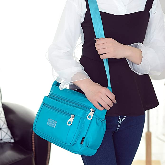 WOMEN'S CROSSBODY WATER RESISTANT PURSE PERFECT FOR EVERYDAY OR TRAVEL.