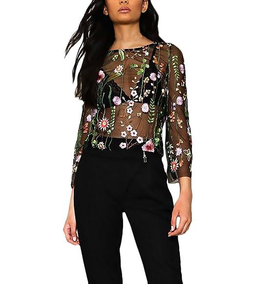 Original blusa de tul con mangas 3/4 y motivos florales. Ideal para fiestas.