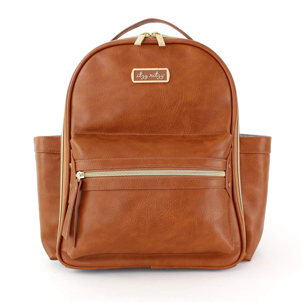 Amazon.com : Itzy Ritzy Mini Diaper Bag Backpack - Chic Mini Diaper Bag  Backpack with Vegan Leather Changing Pad, 8 Total Pockets (4 Internal and 4  External), Grab-Top Handle and Rubber Feet, Cognac : Baby
