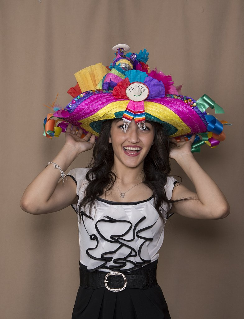 24 x 36 Giclee Print of Alyssa Perez a Student at The The Academy of Careers and Technologies Charter School in San Antonio Texas Models her Creation exhibited in The Hats Off to Fiesta! Event s